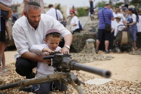 A Jewish toddler is taught how to launch missiles into Gaza.